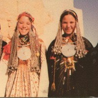 Siwa-girls-dressed-in-their-families-wedding-gowns.-Postcard-image.